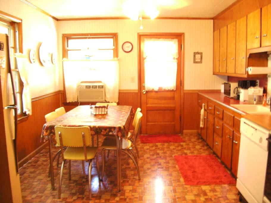 Large completely equipped kitchen with seating of 8