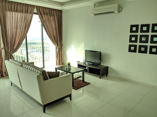 Balcony with a great view, lots of light! TV and wifi included. A/C in living room and bedroom.