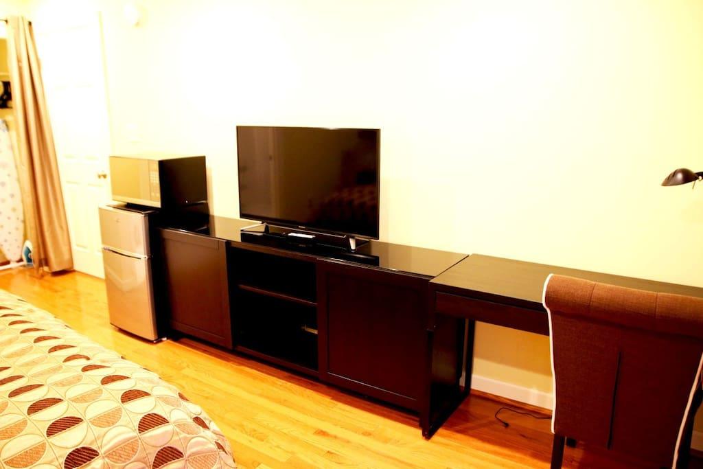 New desk, dresser, TV, refrigerator and microwave
