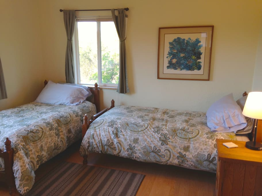 Guest bedroom with 2 single beds and 1 double bed