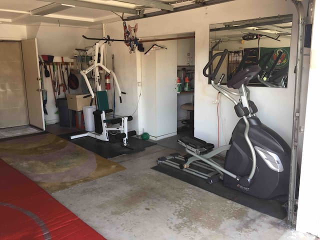 Weight machine and elliptical in garage