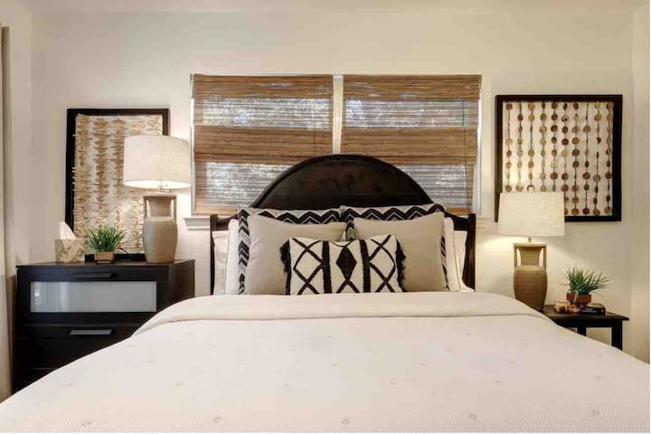 Master bedroom with private bathroom, queen bed and fold out futon that sleeps one.