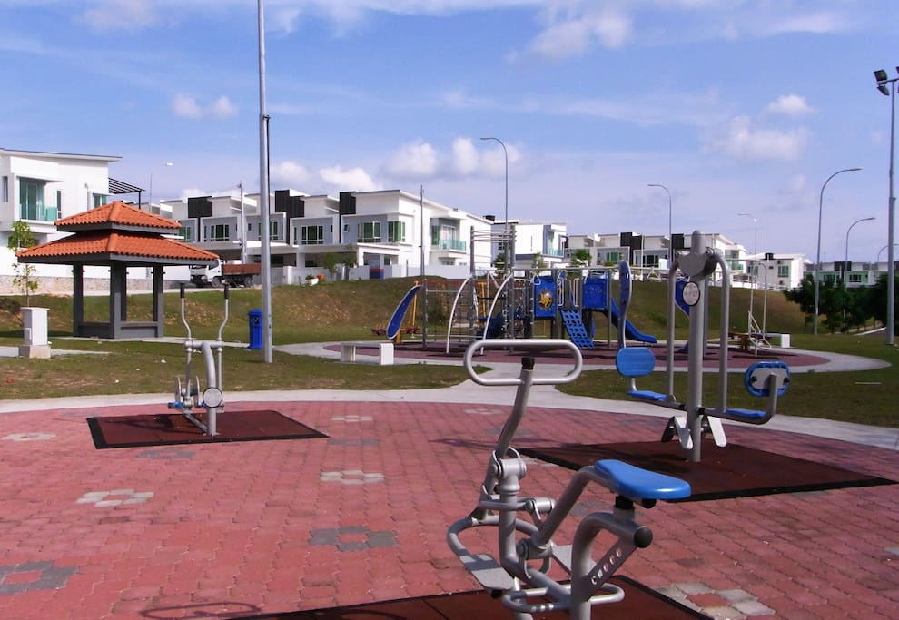 Public workout facilities and playground in front of the house