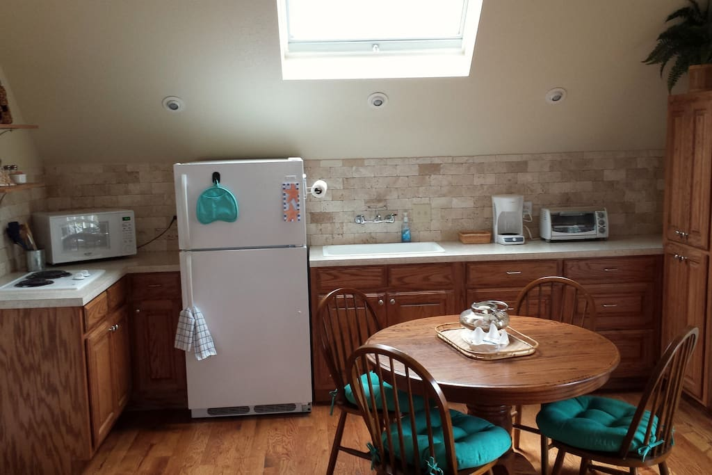 Kitchenette with full size refrigerator/freezer, two burner cooktop, toaster oven, microwave oven, coffee maker.  Pots, pans and dishes included.