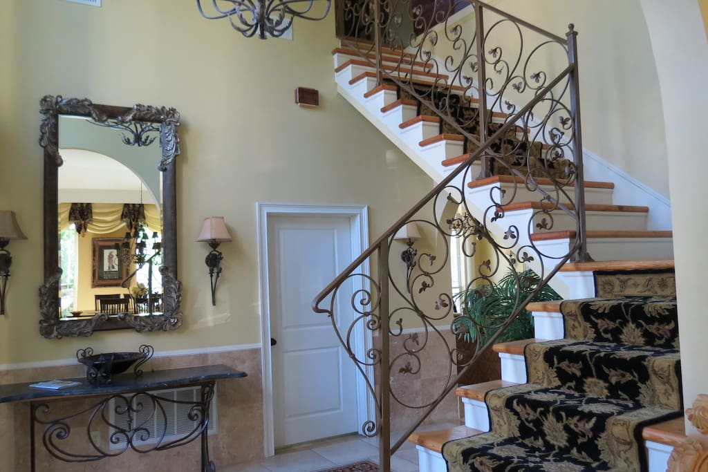 Entry way features beautiful stairway.