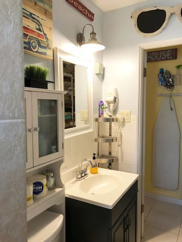 Private walk- in shower located in guest space. Original to the house.  Wall mount hair dryer. Bathroom is updated, but shower is not new.  We hope to have the time to tear it down and update it soon.