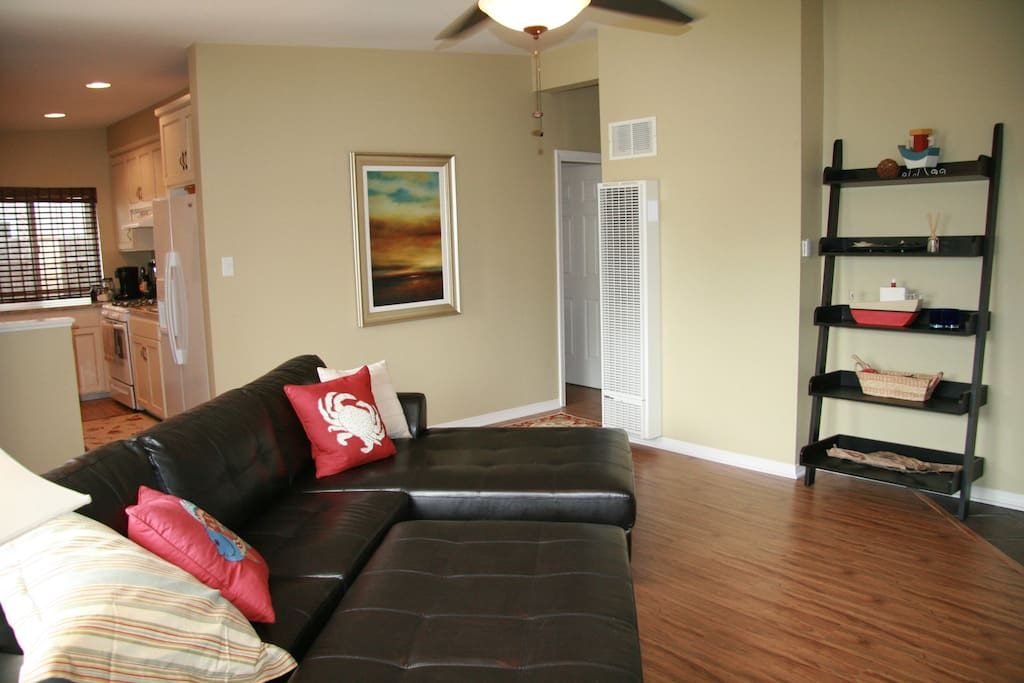 Living room with an open floor plan. We have a new comfortable couch, TV with cable, Wii, & WiFi.