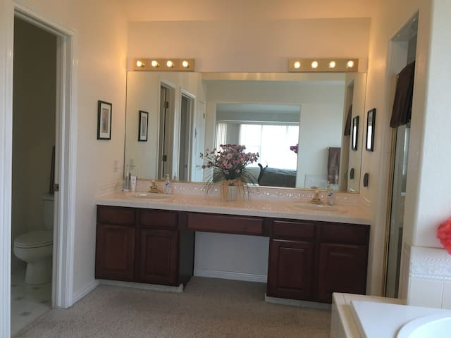 Bathroom with 2 separate sinks.