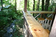Relax at one of the three bars overlooking the creek