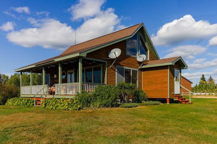 Cozy, dog-friendly, waterfront cabin w/ large yard, porch, dock, & lake views
