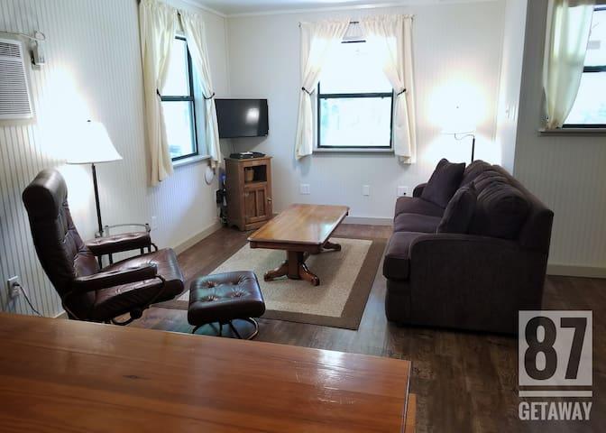 Satellite TV and comfortable furnishings.