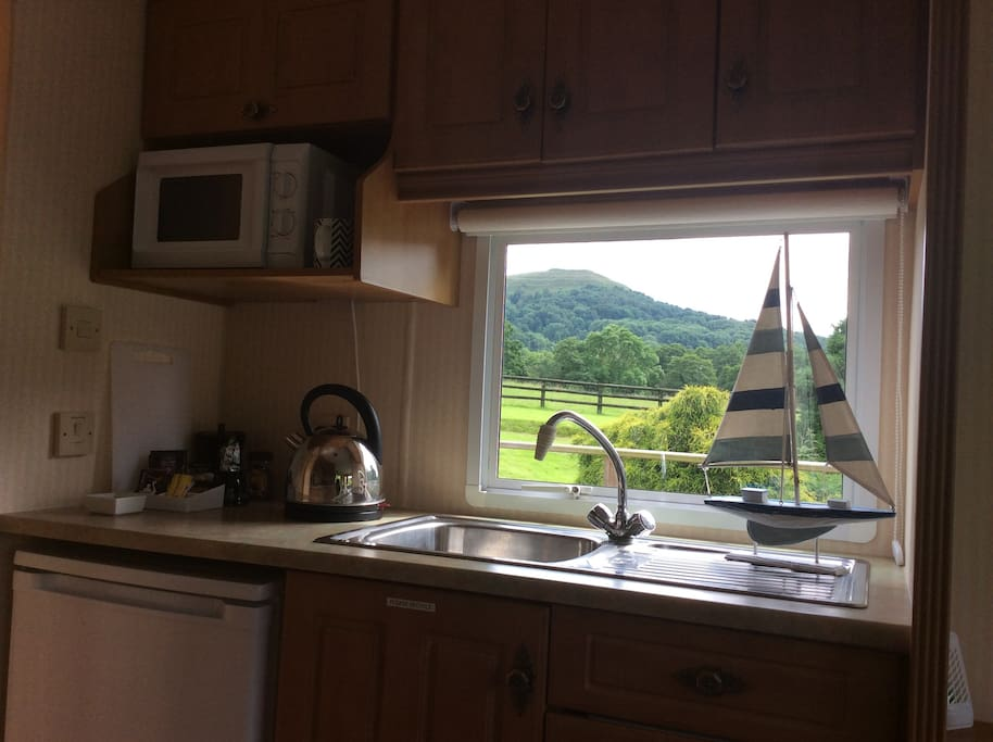 Great views from kitchen. Equipped with microwave, kettle, toaster etc etc.. Welcome milk, tea, coffee
