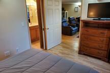 Shows pocket door from bedroom to bathroom on left.