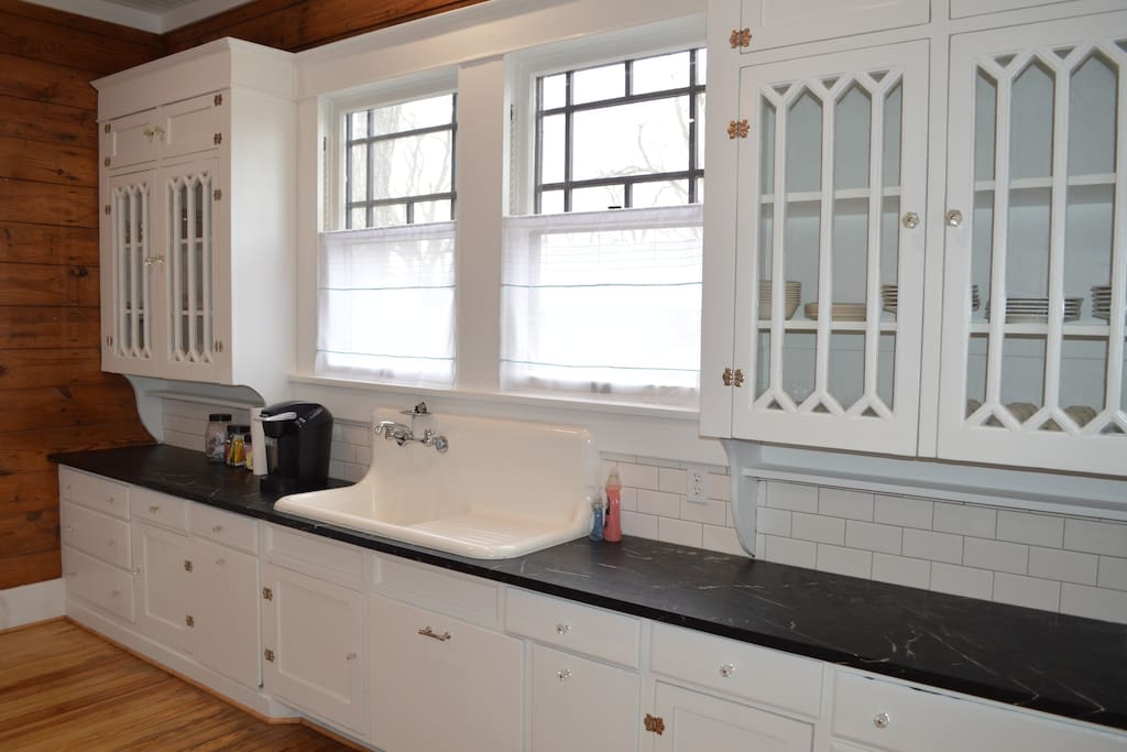 Original cabinets and farmhouse sink