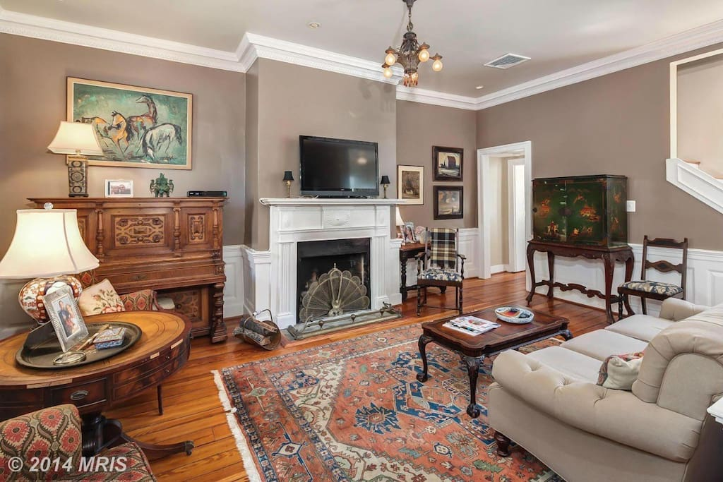 The Livingroom. Original fireplace and wooden floors
