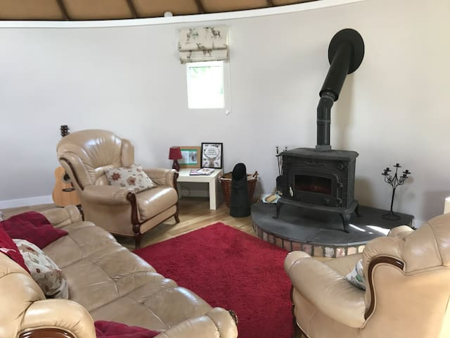 Living area with wood burning stove.