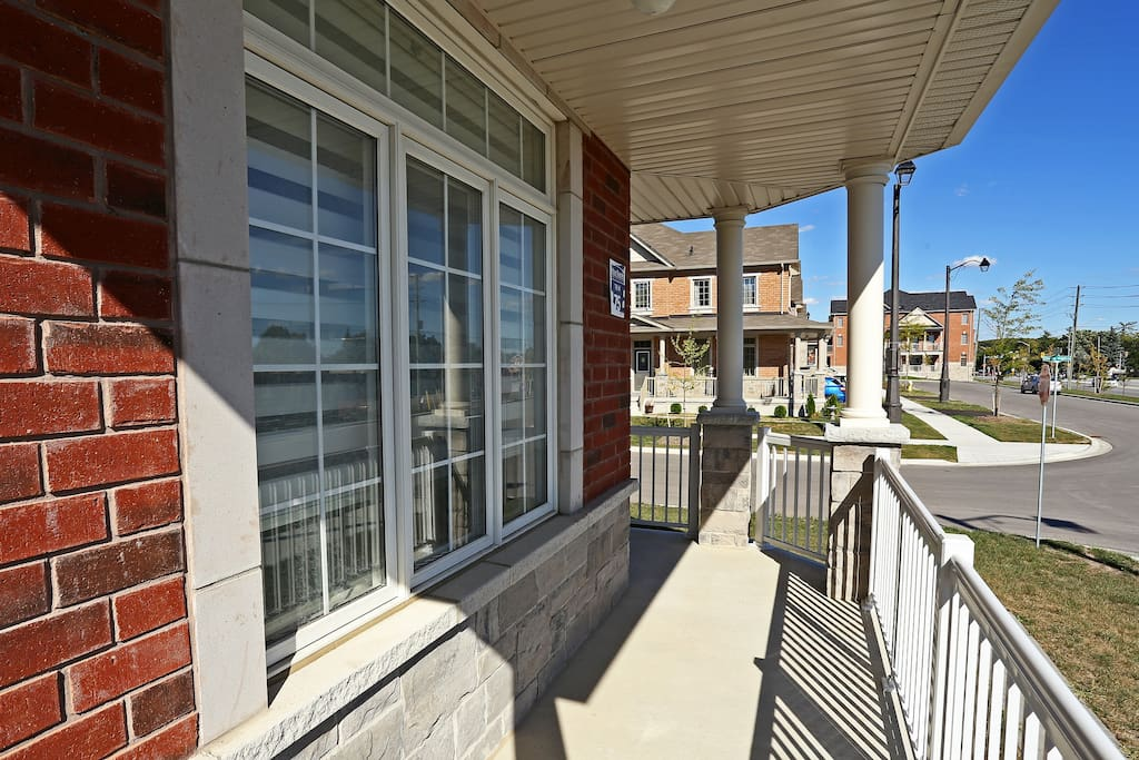 Wrap-around covered porch overlooks the street.