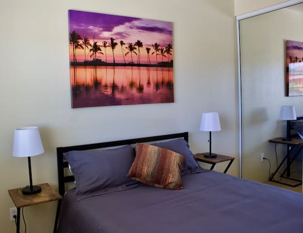 Bedroom 2 is elegantly decorated and has a comfortable Queen bed with down duvet/comforter and ample storage for hang-up clothes