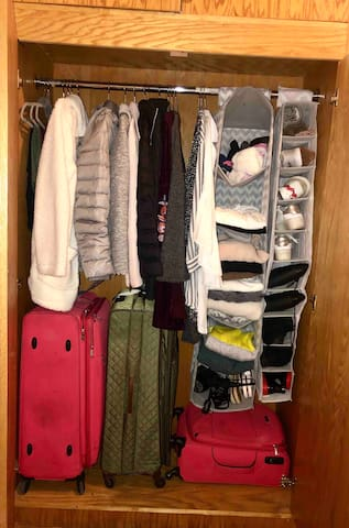 Closet comes empty. This is just a sample so you can see how much space you have for your stuff.