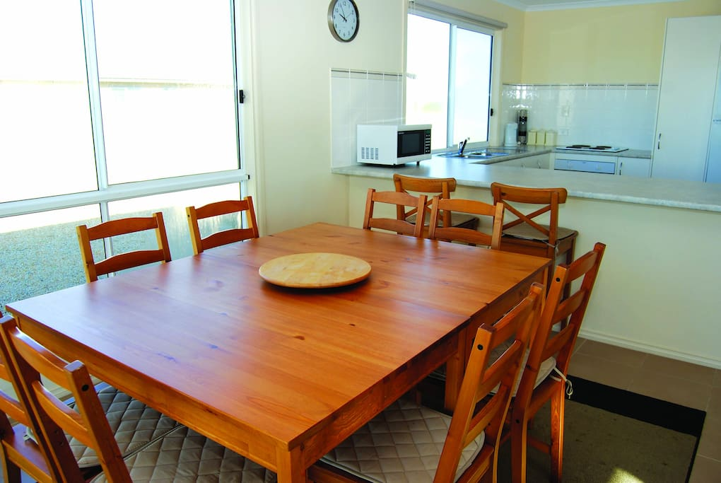 Open plan living and dining for ten.