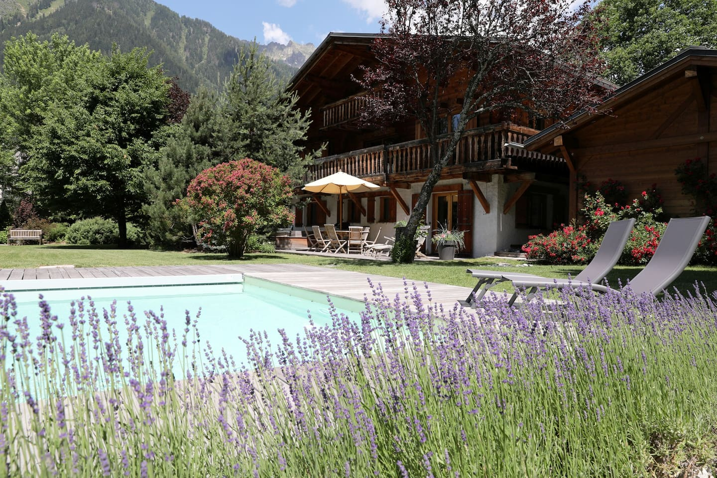 The exterior of Chalet Sauberands in summer with outdoor pool (open from June to September)