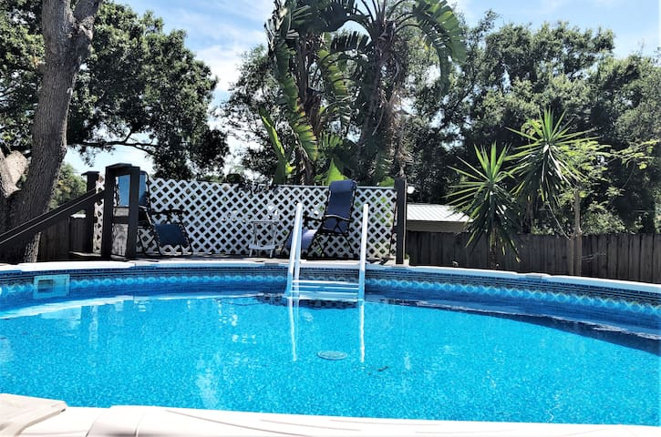 After the hot sandy beach, come relax in the shade and cool off in the pool in the tropical backyard.