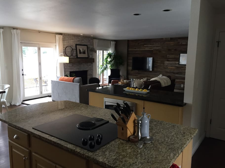 Gourmet kitchen features double oven, large fridge, lots of counter space. Connects to the living and dining spaces -- ideal for entertaining.