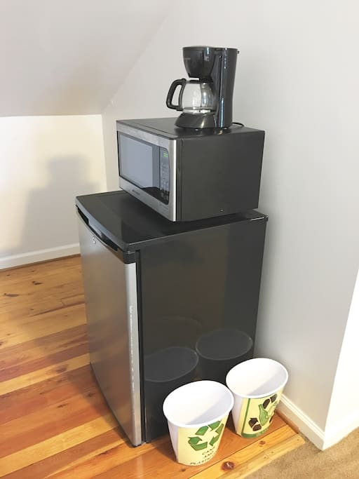 Kitchen nook complete with Keurig, microwave and refrigerator. We offer complimentary bottled water and coffee.