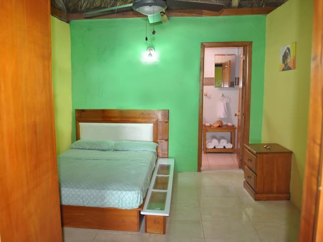 Bedroom 2 with queen size bed, closet and ceiling fan (mosquito net available)