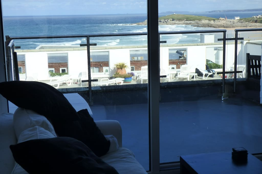 View of the private pool and Fistral Beach from the lounge