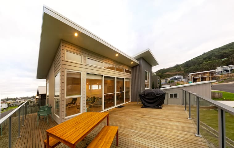 Gorgeous, architecturally designed, contemporary home with wrap around deck for entertaining.