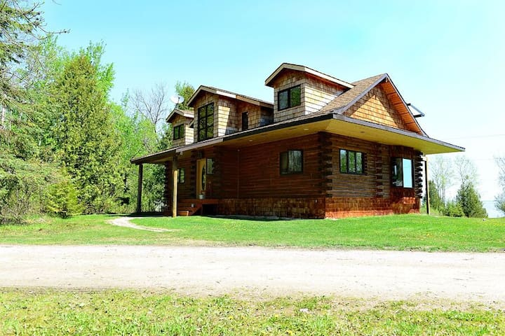 Beautiful Log Home on acreage in Traverse Bay near