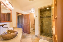 River Suite's attached bathroom with huge walk-in river stone shower and boulder sink