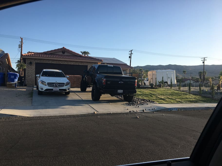 2 cars park in front and can park 4 cars on side of house