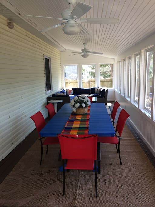 Beautiful  new 30 foot screened in porch with 8 ft. dining table and L shaped seating