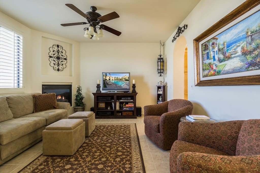 """Living area features tiled flooring and 40"""" Sony TV with DVD player."""