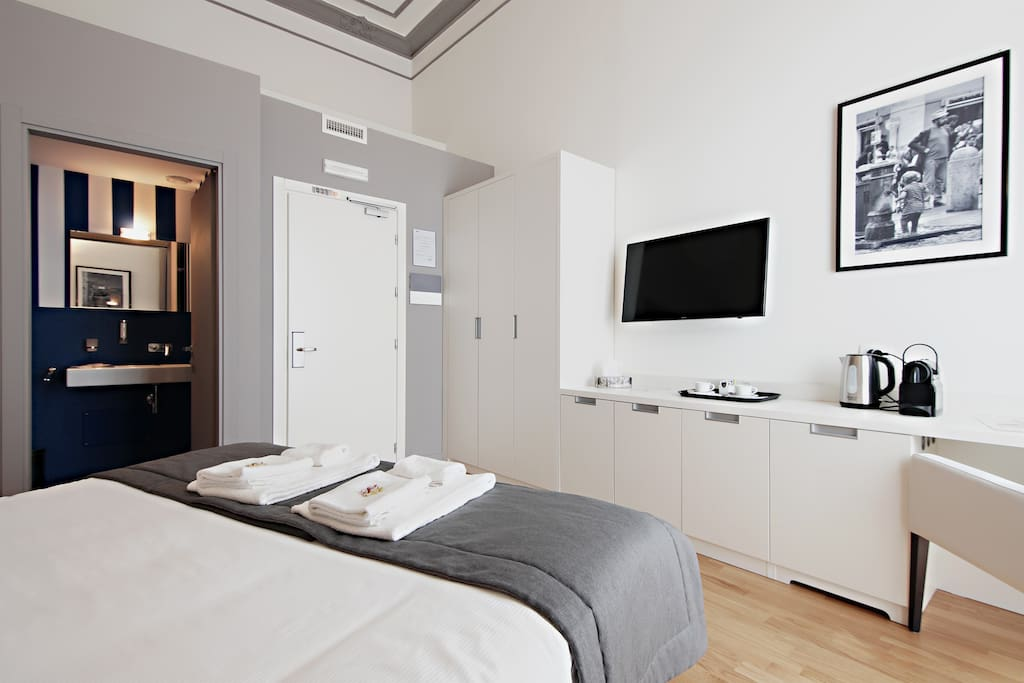 View of the double bedroom with a/c, tv, Nespresso machine and private balcony