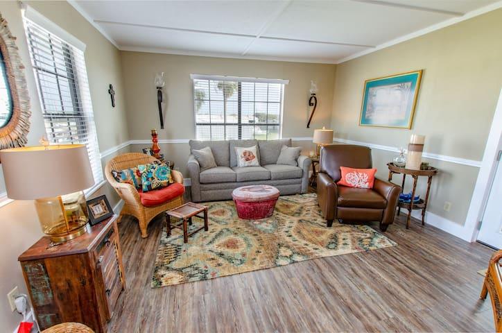 Large upper living room with custom sofa sleeper with nice Tv