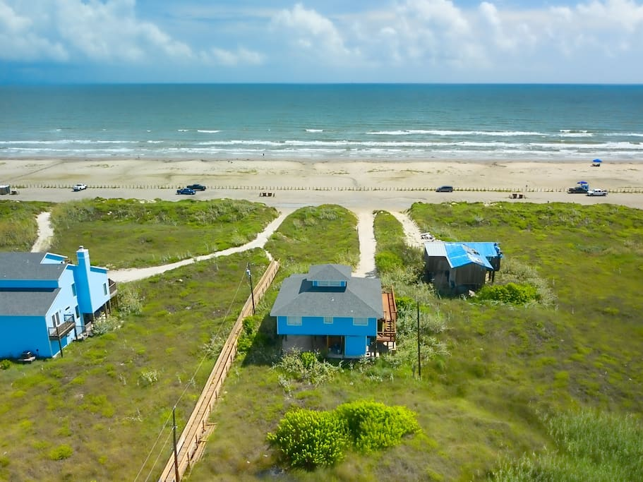 Follow the sandy path directly from the property to the beach.
