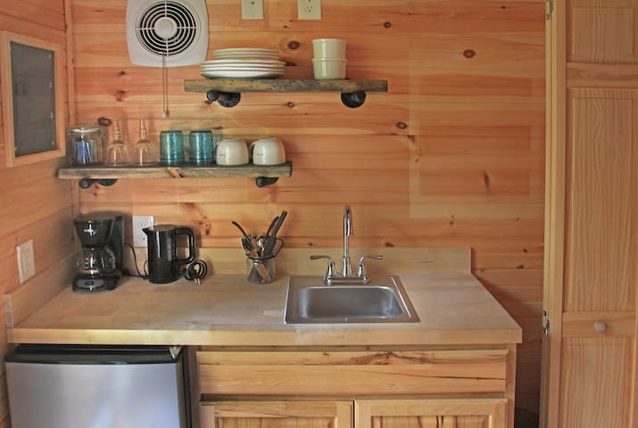 Enjoy a cup of coffee or tea in the kitchen, which features a mini-fridge and freezer; sink; dishes, glasses and silverware; and a welcome basket of snacks and local goodies.