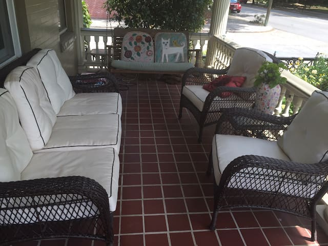 The front porch is perfect for perfect for people watching or just chilling.