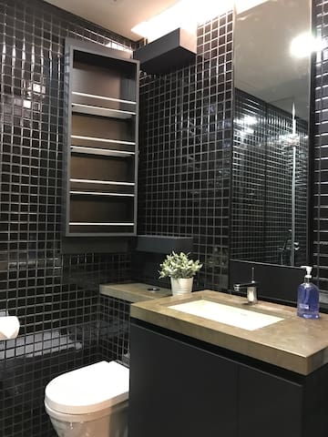 Toilet with storage shelves