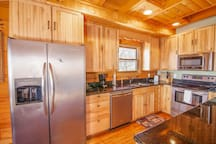 Kitchen with Custom Wood Cabinetry and Stainless Appliances