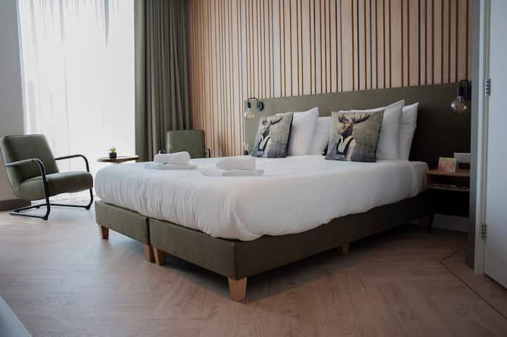 Luxe hotelkamer met terras