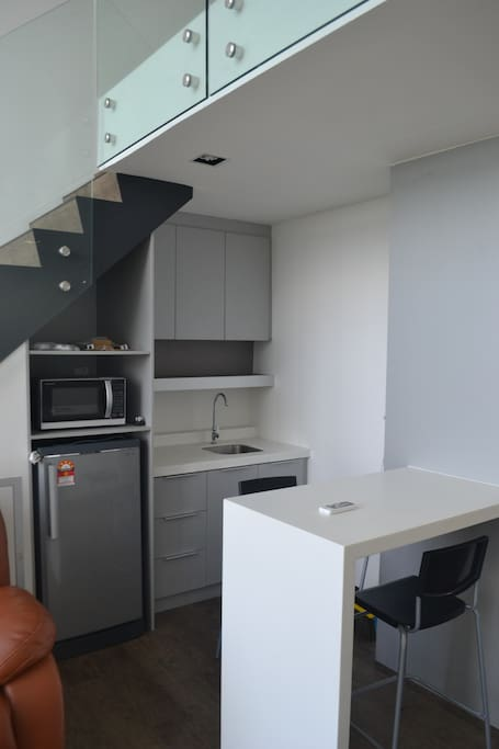 Kitchen with microwave oven and refrigerator