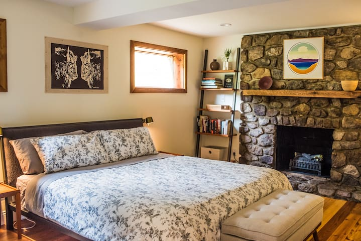 Large Master bedroom downstairs with flat screen tv