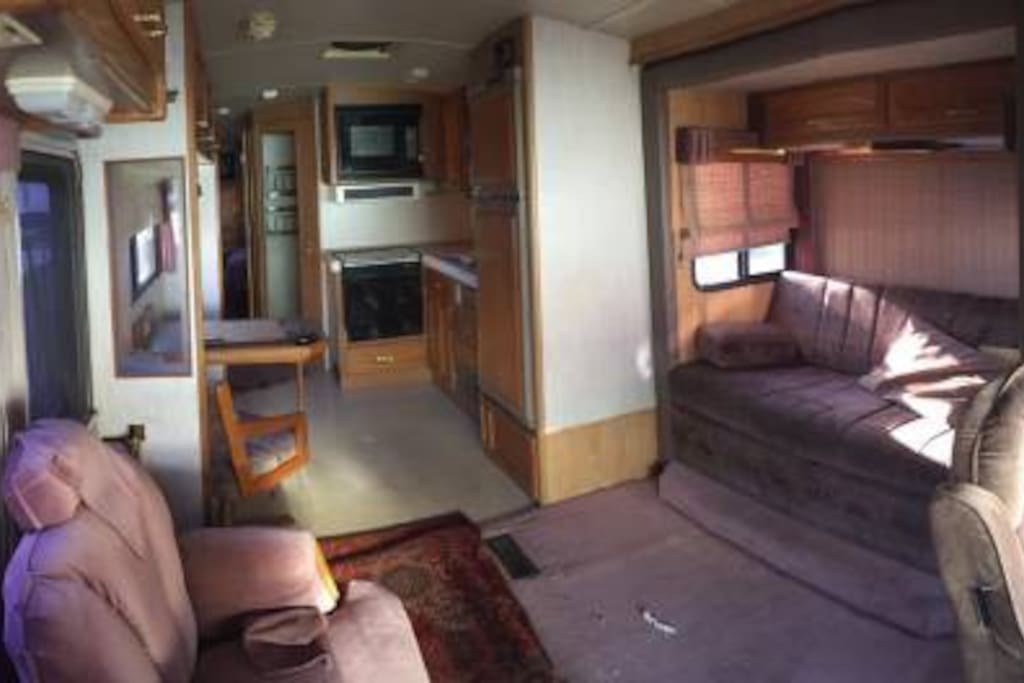 RV has large living area with slide out.  RV interior is in flawless condition and has all amenities from freezer to oven, microwave, dual air conditioning system, queen size walk-around bed, shower, bath, forced air heating.