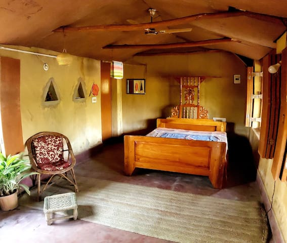 A very cozy and rustic bedroom furnished with authentic local handicrafts