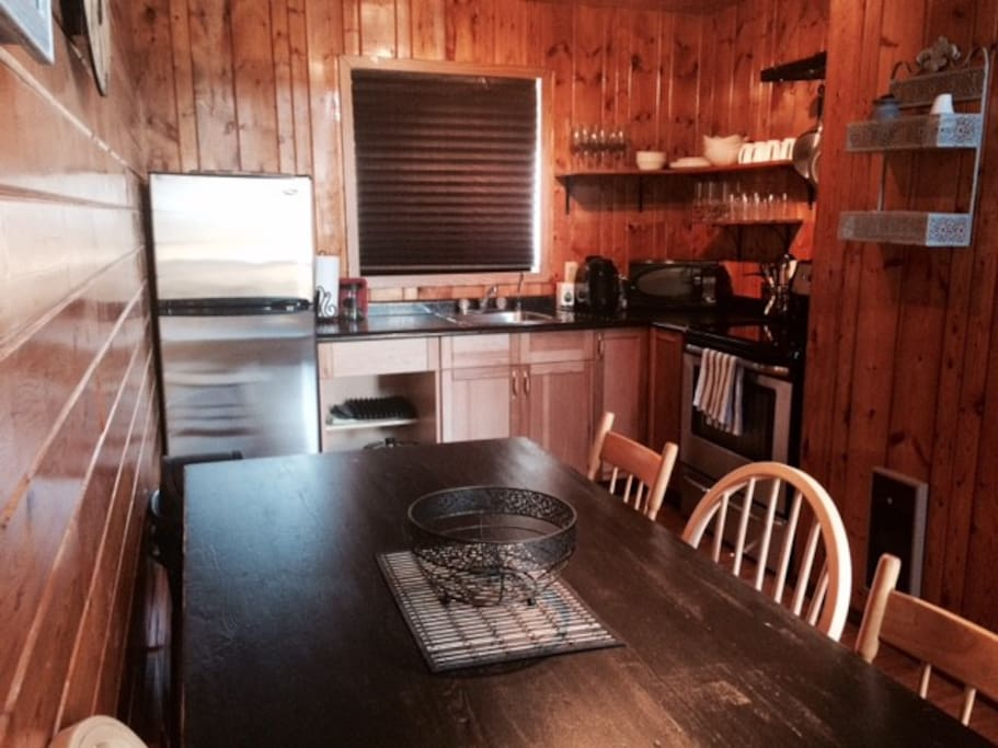 Fully equipped eat-in kitchen. Large table easily seats 6.
