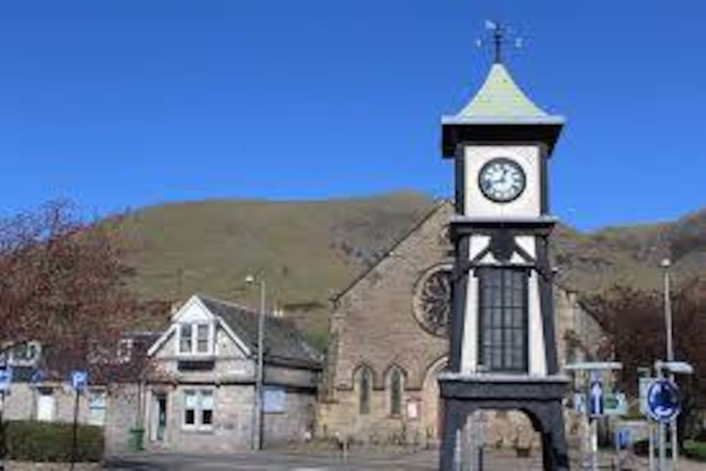 The property is opposite the village clock